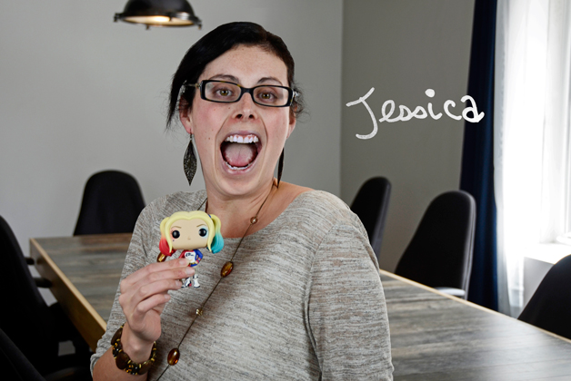 Headshot of Jessica Sawicz holding Harley figure with her signature